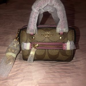 Mini coach purse that can also be a cross body